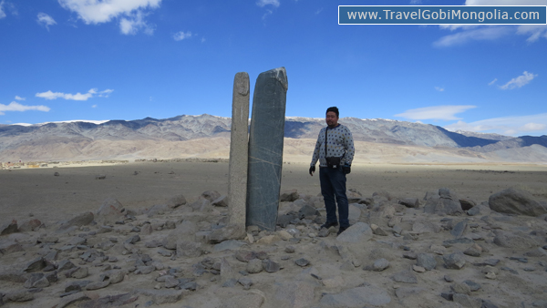 our guide standing in next of human stone & deer stone together