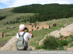 a tourist is taking the photo of Mandzushir Monastery Ruin