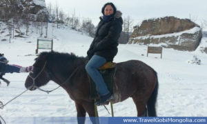 horse riding in winter in Mongolia