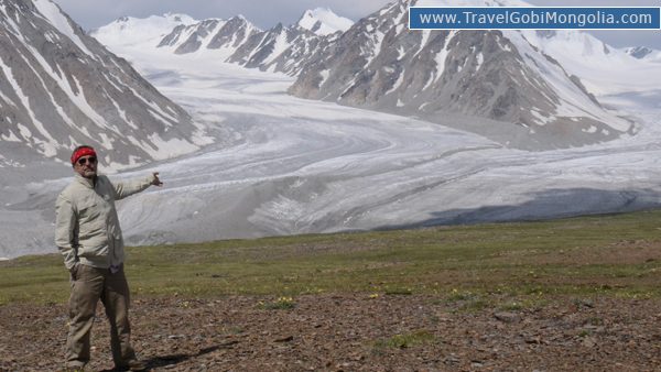 our customer is pointing to Altai Five Bogd Mountains