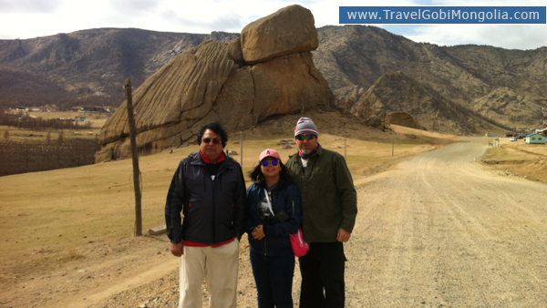 our customers are standing in front of Turtle Rock at Gorkhi-Terelj National Park
