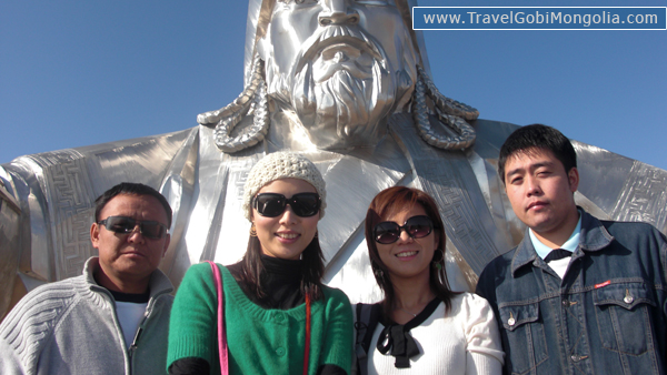 our driver & guide with our 2 customers in Genghis Horse Statue