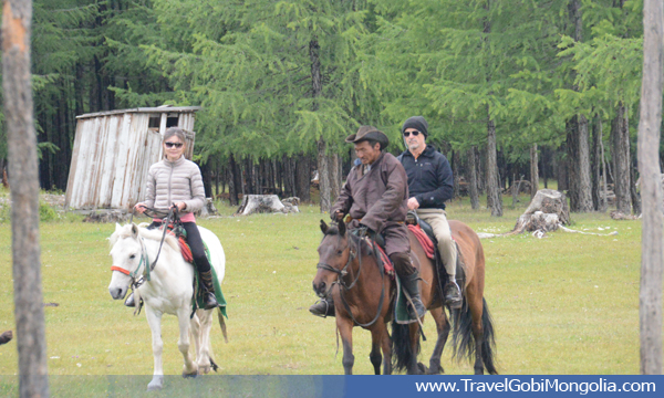 our guide & our customer are riding horse in Khuvsgul Lake