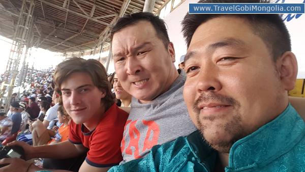 our guide & our customer is watching opening ceremony of Naadam festival