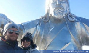 our customers in front of Genghis Khan Statue face in winter