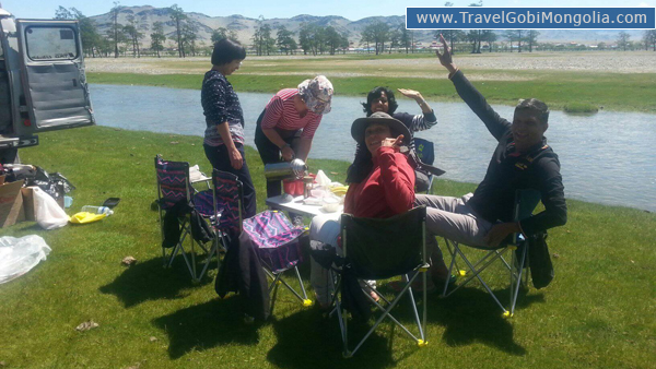 our customers are enjoying picnic lunch around Tsengel village during Altai tour.
